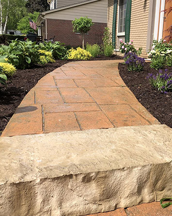 paved walkway installation, stone slab and mulch garden